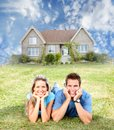 Happy family near new house real estate concept Royalty Free Stock Photo