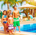 Happy family near pool cute having fun on luxury tropical resort mother with children looking up in sky summer holidays love Royalty Free Stock Images