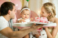 Happy family one year old little girl with daddy and mammy solemnize birthday laughter horizontal photo Royalty Free Stock Photo