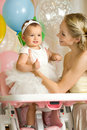 Happy family one year old little girl with mammy vertical photo Stock Images