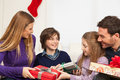 stock image of  Happy family opening the christmas gift