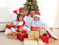 Happy family opening Christmas presents Royalty Free Stock Photography