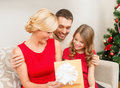 Happy family opening gift box christmas x mas winter happiness and people concept Royalty Free Stock Photos