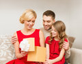 Happy family opening gift box christmas x mas winter happiness and people concept Royalty Free Stock Photography