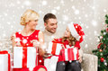 Happy family opening gift boxes christmas x mas winter happiness and people concept Royalty Free Stock Photography
