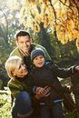 Happy family outdoor at autumn Royalty Free Stock Photo