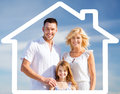 Happy family outdoors home happiness and real estate concept over blue sky background and house shaped illustration Royalty Free Stock Image
