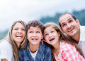 Happy family outdoors looking up and smiling Stock Photo