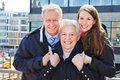 Happy family outdoors senior in a city Royalty Free Stock Image