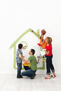 Happy family painting their home together Royalty Free Stock Photo