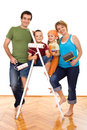 Happy family with painting utensils Royalty Free Stock Photo
