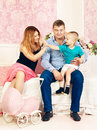 Happy family parents and cute baby playing on bed Royalty Free Stock Photo