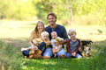 Happy Family of 5 People and Dog in Sunny Garden Royalty Free Stock Photo