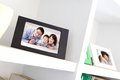 Happy family photo on white bookshelf at home Royalty Free Stock Image