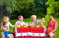 Happy family on picnic colorful outdoors big Stock Photography