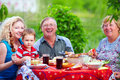 Happy family on picnic summer outdoor together in colorful outdoors Royalty Free Stock Photo