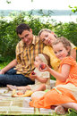 image photo : Happy family picnicking outdoors