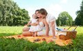 Happy family picnicking in the park picture of Royalty Free Stock Images