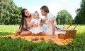 Happy family picnicking in the park picture of Royalty Free Stock Photography