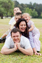 Happy family piled up  on the park Royalty Free Stock Photo
