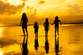 Happy family playing on the beach Royalty Free Stock Photo