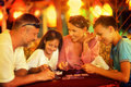 Happy family playing cards Royalty Free Stock Photo