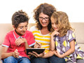 Happy family playing on digital tablet pc mother and children having fun using isolated white background Royalty Free Stock Photography