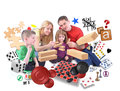 Happy family playing games together on white a is with various of puzzles blocks and checkers an isolated background Stock Photography