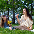 Happy family playing outdoors mom and daughter have fun relaxing in the park Stock Photo