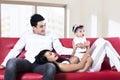 Happy family playing on sofa Royalty Free Stock Photo