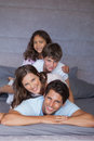 Happy family playing together on the bed Royalty Free Stock Photo