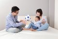 Happy family playing toy soccer Stock Image