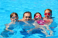 Happy family pool Stock Images