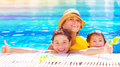 Happy family in the pool have fun relaxation aquapark mother with two cute kids swimming cool water spending together summer Royalty Free Stock Photos