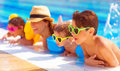 Happy family in the pool having fun water mother with three kids enjoying aquapark beach resort summer holidays pleasure Stock Photo