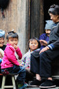Happy family in the poor old village in china lady girl kid a chinese falimy dong Royalty Free Stock Image