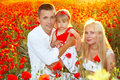 Happy family on poppies flowers Royalty Free Stock Photo