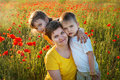 Happy family on the poppy field