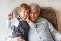 Happy family portrait with grandfather and little grandson Stock Images