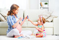 Happy family pregnant mother and child daughter preparing clothi Royalty Free Stock Photo