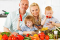 Happy family preparing a healthy dinner at home is in the kitchen Royalty Free Stock Photography