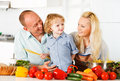 Happy family preparing a healthy dinner at home. Royalty Free Stock Photo