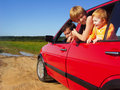 Happy family in red car Royalty Free Stock Photo