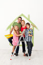 Happy family redecorating their home with kids together Stock Photos