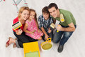 Happy family redecorating their home painting sitting together with utensils Stock Image