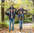 Happy family relaxing in autumn park outdoors Royalty Free Stock Image
