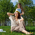Happy family relaxing in nature mom and daughter have fun the park Stock Photos