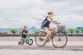 Happy family is riding bikes outdoors and smiling. Mom on a bike Royalty Free Stock Photo