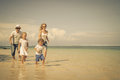 Happy family running at the beach Royalty Free Stock Photo