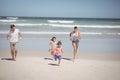 Happy family running at beach